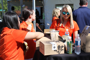 Photo of OneEighty Foundation volunteers handing out waters at the Backyard Barbecue